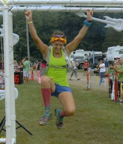 My favorite jumper pic through the Finish Line of the Run Woodstock 50 Mile Race in 2013