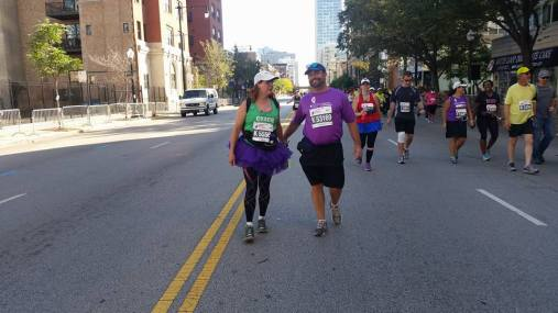 Coach Patrice helping Jim in at mile 25.