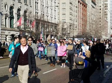 Demonstrators marching on Michigan Avenue